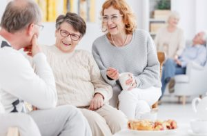 A group of elderly people talking and enjoying each other's company